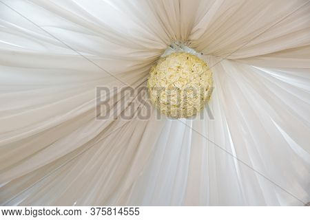 There Is A White Curtain On The Ceiling . White Rose Ball On The Ceiling .