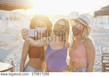 Girls Taking A Selfie With Face Mask Outside For Coronavirus Protection - Teenagers In Vacation At A