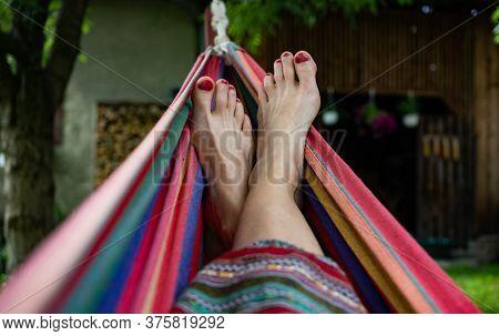 woman feet relaxing in hammock summer zen