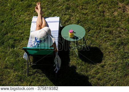 top view of woman sunbathing in back yard summer fun