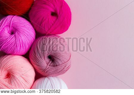 Acrylic Balls Of Yarn On A Pink Background. Nuance Color Combination. Skeins Are Located Vertically