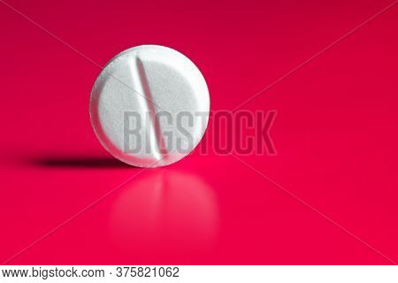 Large White Pill On A Red Background. Copy Space