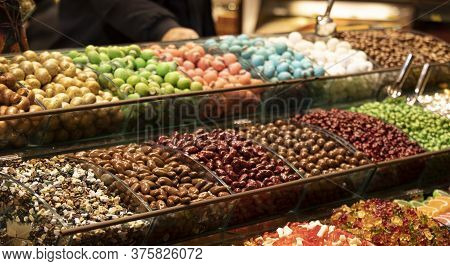 Colorful Candies. A Photo Was Taken From The Side. Apart From Sugar, There Is Almond Content. Close-