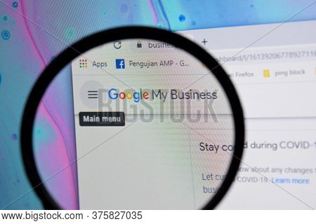 Google My Business Website Home Page On Computer Screen On Magnifying Glass. My Business Is A Web Br