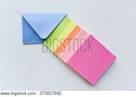 Selective Focus, Blue Envelope In The Center With Bright Colored Rectangles Directed Towards The Cor