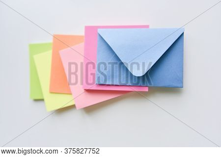 Selective Focus, Blue Envelope In The Center With Bright Colored Rectangles Spreading Under It