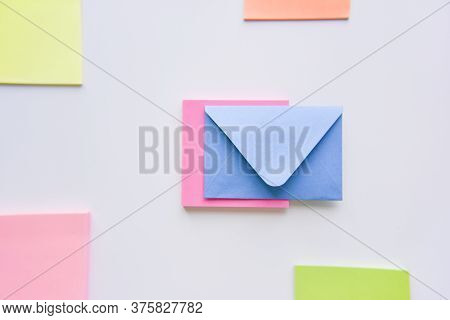 Selective Focus, Blue Envelope In The Center With Bright Colored Rectangles On Sides
