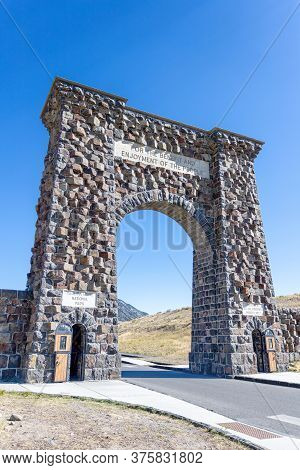 Historic Roosevelt Arch At The North Entrance Of Yellowstone National Park In Gardiner, Montana. The