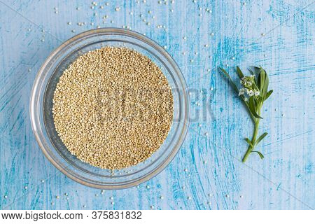 Raw Quinoa Grains Inside Transparent Bowl, On Blue Table