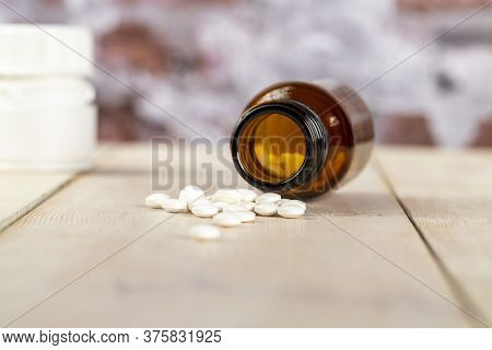Home Medicine.glass Bottles Of Medicine And Roubd White Pills