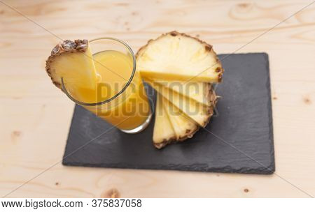 Glass Of Pineapple Juice With Pineapple Slices. Pineapple Food.