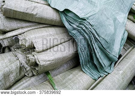 Moscow, Russia - August 17, 2019: Pile Of Large Synthetic Garbage Bags Close-up On The Rack In A Bui