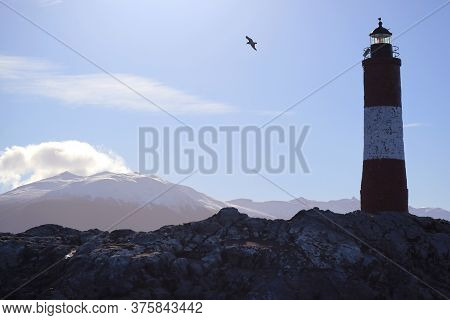 Les Eclaireurs Lighthouse On A Rocky Islands In Beagle Channel, The Iconic Landmark Of Ushuaia, Tier