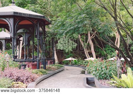 Gazebo Pavilion In Garden Park. Tranquil Nature Scene