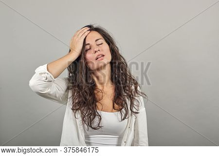 Stress Or A Headache Grimacing In Pain Holds The Back Of Neck Indicating Location. Fatigue During Wo