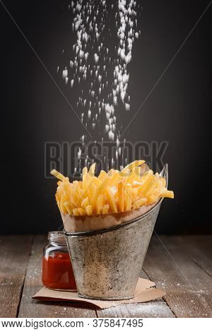 Pinch Of Salt Falling On French Fries