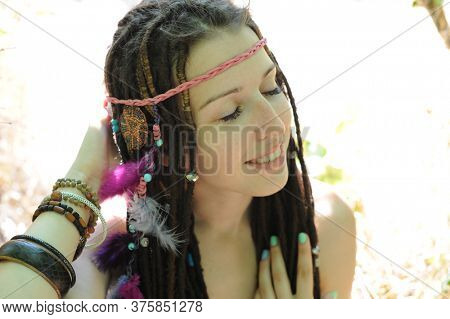 Indie, hippie style woman with dreadlocks, outdoor