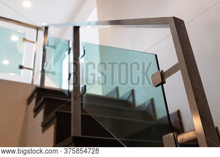 Modern Minimalist Style Stairs With Brown Wooden And Steel Handrails In Empty Modern Home Building I