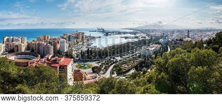 Cityscape Of Malaga On A Cloudy Winter Day, With The Harbour And Some Of The Main Monuments To Be Re