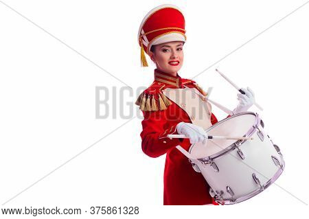 Drummer In A Red Uniform Drums On A Drum, Show Program And Celebration. Copy Space On The Left