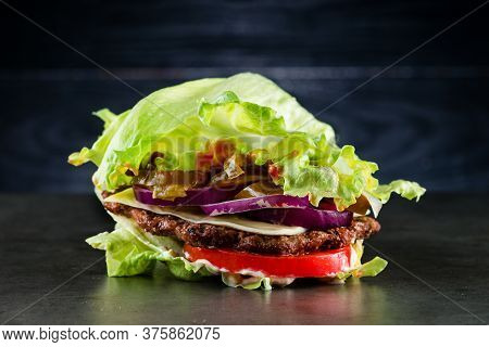 Low-carb Burger With Salad And Beef, Homemade Bunless All Beef Lean Hamburger Lettuce Wrap Which Is