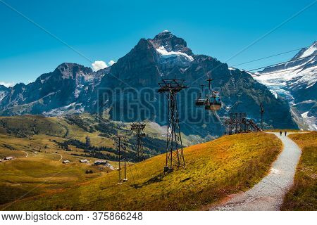 Cable Car From Grindelwald To First Near The Top Station In Summer And Panoramic View On Snow Capped