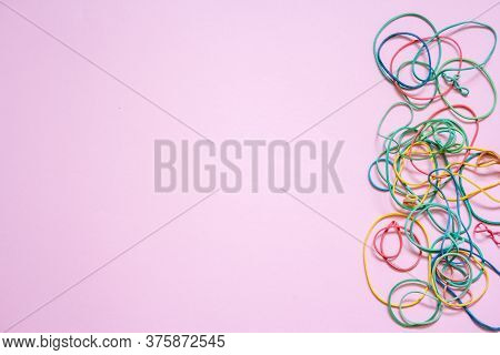 A Multicoloured Background Showing A Heap Of Colourful Elastic Rubber Bands