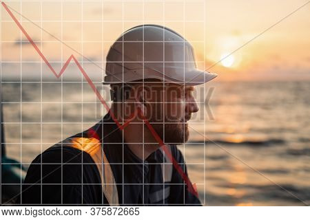 Concept Of Falling Market In Marine Industry With Downward Graphics. Marine Deck Officer Or Chief Ma