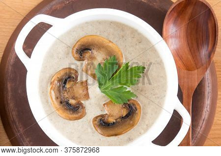 Cream Soup In A White Plate. Mushroom Soup. Potato Soup With Mushrooms. Top View, Wooden Background.