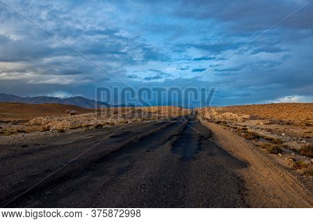 Tajikistan. Dramatic Evening Sky Over The Pamir Highway In The Area Of The High-altitude Lake Bulunk