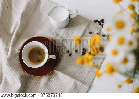 Summer Still Life Scene. Cup Of Coffee And Milk Pitcher. Feminine Styled Photo. Floral Composition W