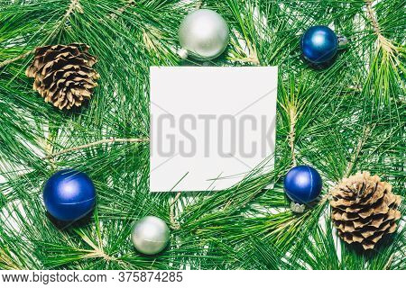 X-mas Background With Christmas Balls, Pinecones And Green Pine Leaves. Square Copy Space For Text