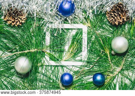 X-mas Background With Silver Decoration, Christmas Balls, Pinecones And Green Pine Leaves. Empty Squ
