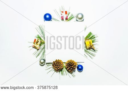X-mas Background With Christmas Balls, Presents, Pinecones And Green Pine Leaves. Square Copy Space