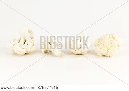 Close-up Of Some Delicious White Cauliflower Illustrating A Healthy Lifestyle Isolated On White Back