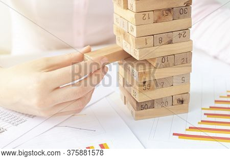 Planning, Risk And Strategy In Business, Businesswoman And Engineer Gambling Placing Wooden Block On