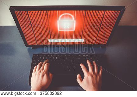 Two Hands Typing On A Keyboard. Locked Encrypted Data On Red Screen. Hacking Conept