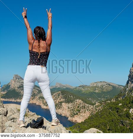 Portrait Of A Beautiful Young Hispanic Latina Woman, Doing Top Conquest Position, On The Mountain Cl