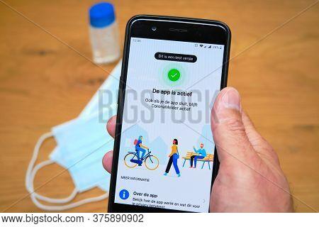 Bennekom, Netherlands, Juli, 7, 2020:smartphone With Dutch Corona Tracking App Named:coronamelder. F