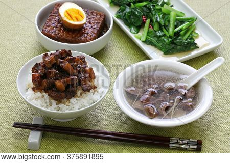 taiwanese home cooking: braised pork rice, chicken gizzard soup, simmered tofu and egg, and stir fried greens
