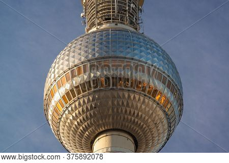 BERLIN, GERMANY - SEPTEMBER 17, 2013: Close up of the Fernsehturm in Berlin. The television tower was completed in 1969.