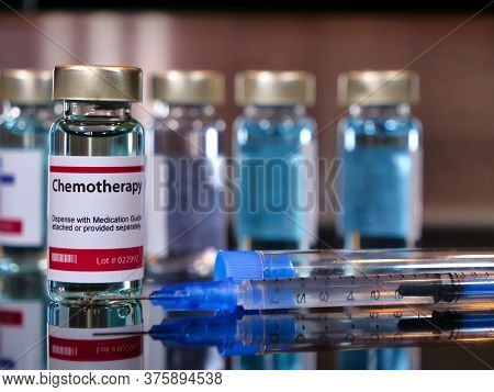 Vial Of Chemotherapy With Syringe For Cancer Treatment.