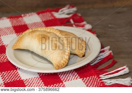 Plate With Empanadas, Traditional Of Argentine Gastronomy