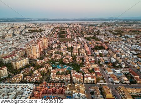 Drone Point Of View Spanish Resort Townscape Of Torrevieja During Sunset Evening Light. Aerial Photo