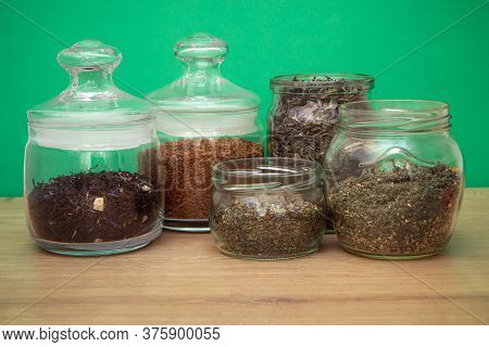 Assortment Of Tee And Coffee In Glass Jars On Wooden Table. Zero Waste Concept.