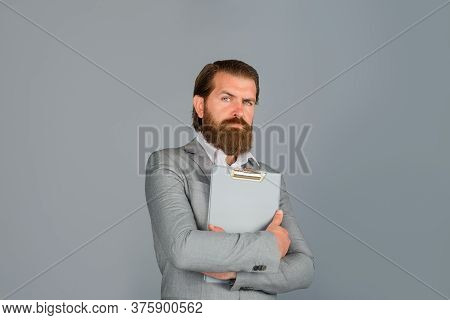 Bearded Businessman With Folder. Business Man Wearing Formal Suit Holds Notebook. Businessman Holds