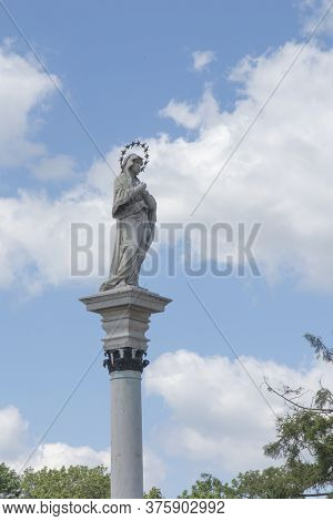 Statue Of Our Lady Of The Immaculate Conception In The Middle Of Square In Front Of The Monastery Ja