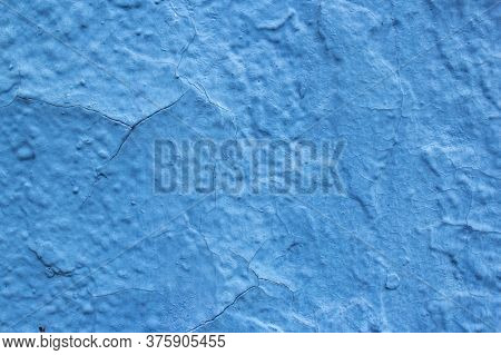 The Wall Is Coarsely Painted With Dark Blue Paint. Traces Of Blue Paint On The Wall Surface. Beautif