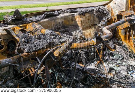 Remains Of Dashboard And Steering Shaft Of Burnt Car.damage As Result Of Spontaneous Combustion Or A