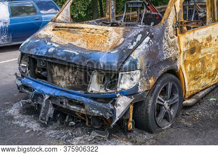 Fragment Of Burnt Car. Damage As Result Of Spontaneous Combustion Or Arson. Insurance Event